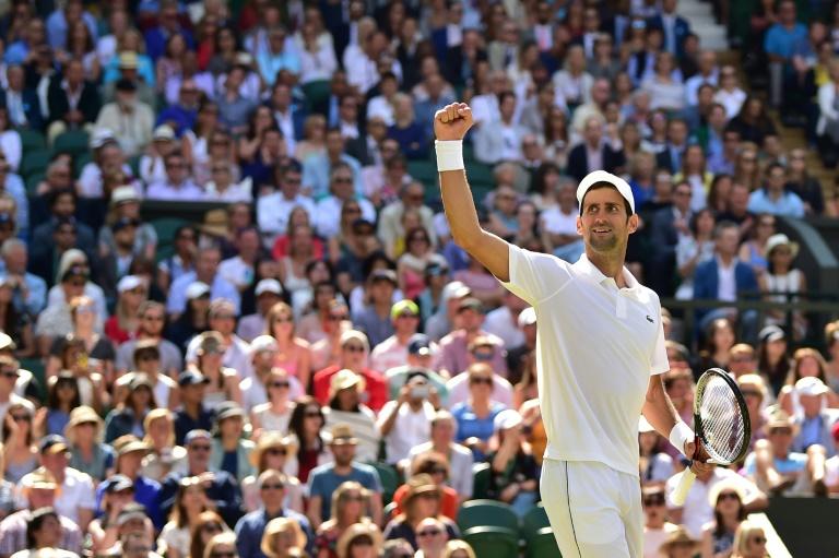 Djokovic into Wimbledon semi-final, blasts 'unnecessary' warnings