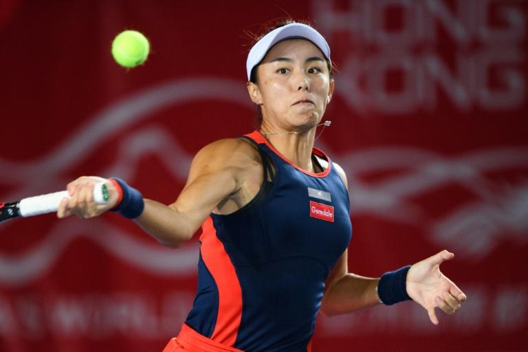 Wang on brink of year's biggest win as rain stops play