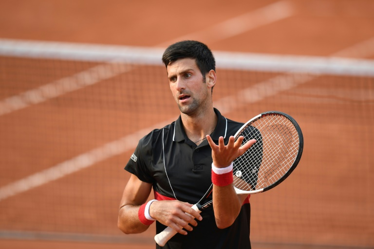 Troubled Djokovic to play Wimbledon warm-up at Queen's Club