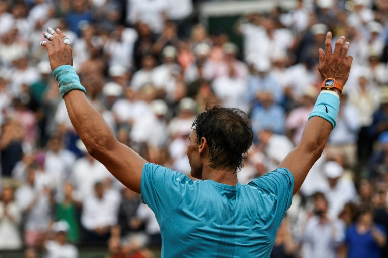 Nadal wins 11th French Open despite late injury scare