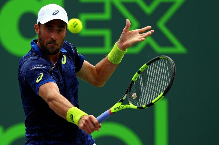 Johnson outlasts Sandgren to repeat as US Clay champion
