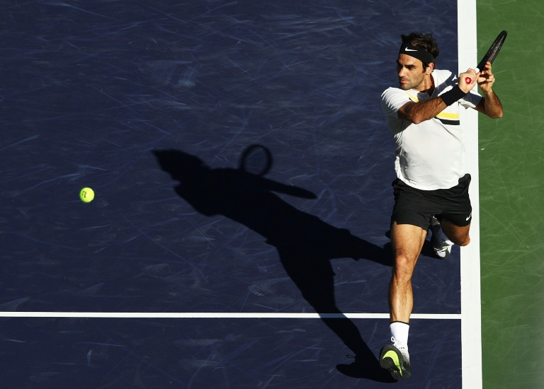 Federer takes care of business, Djokovic crashes out