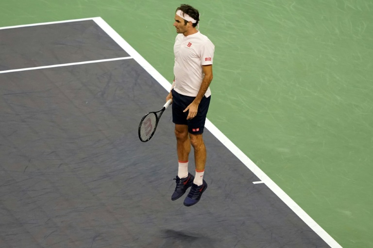 Federer does family proud to battle into Shanghai quarters