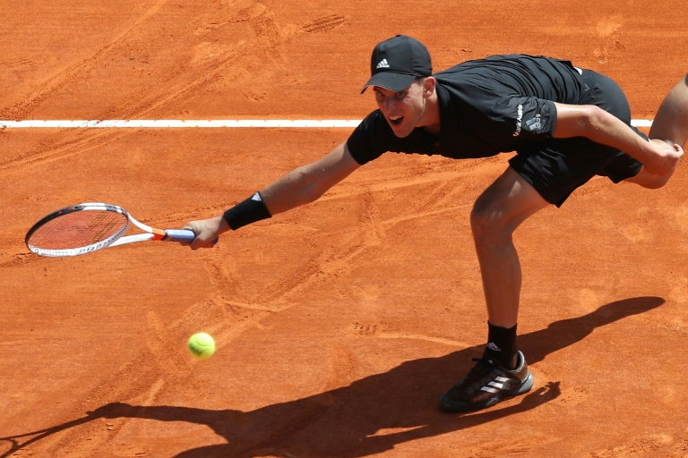 Thiem saves match point in victory over Rublev